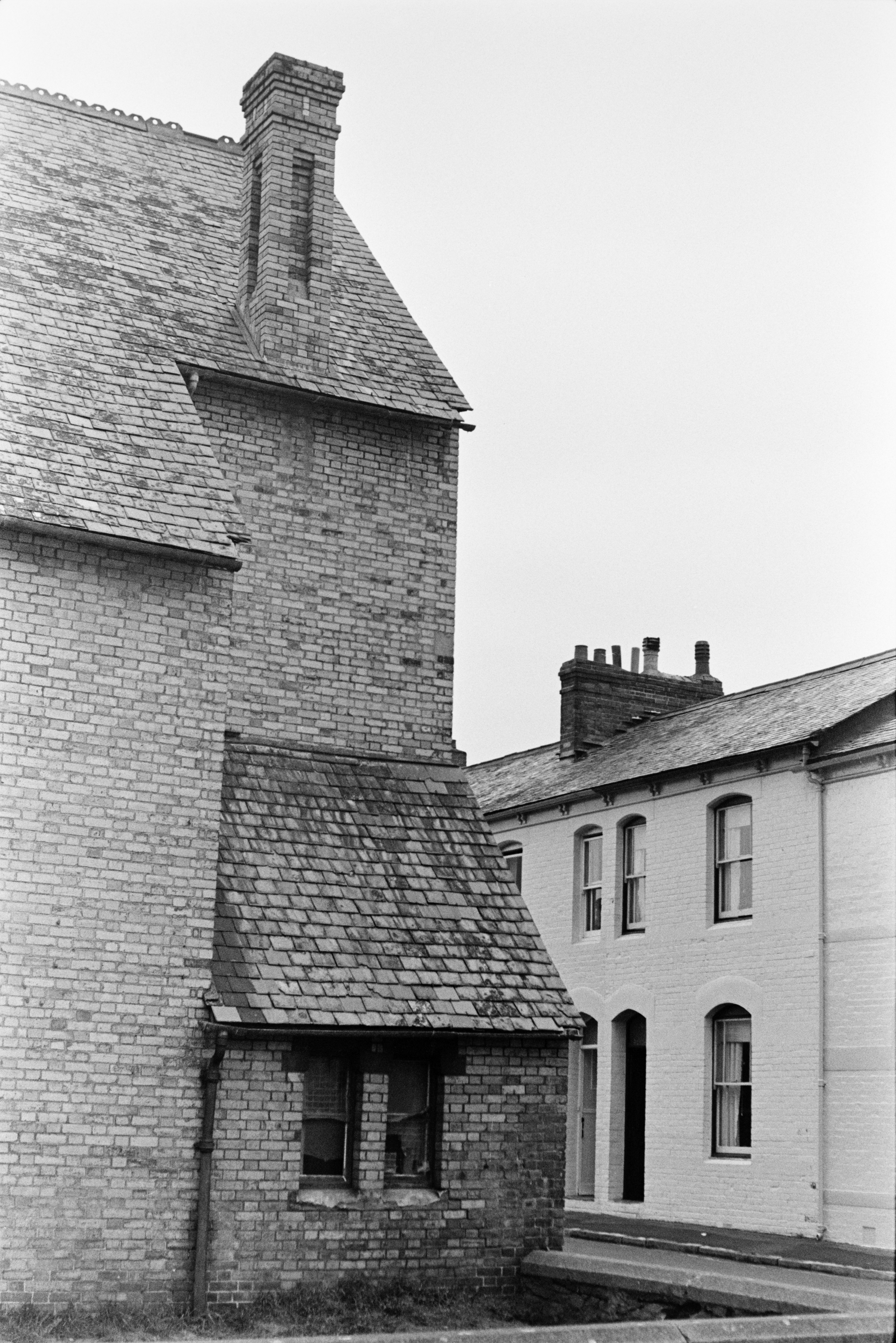 A brick house with a brick chimney and slate roof in Barnstaple.