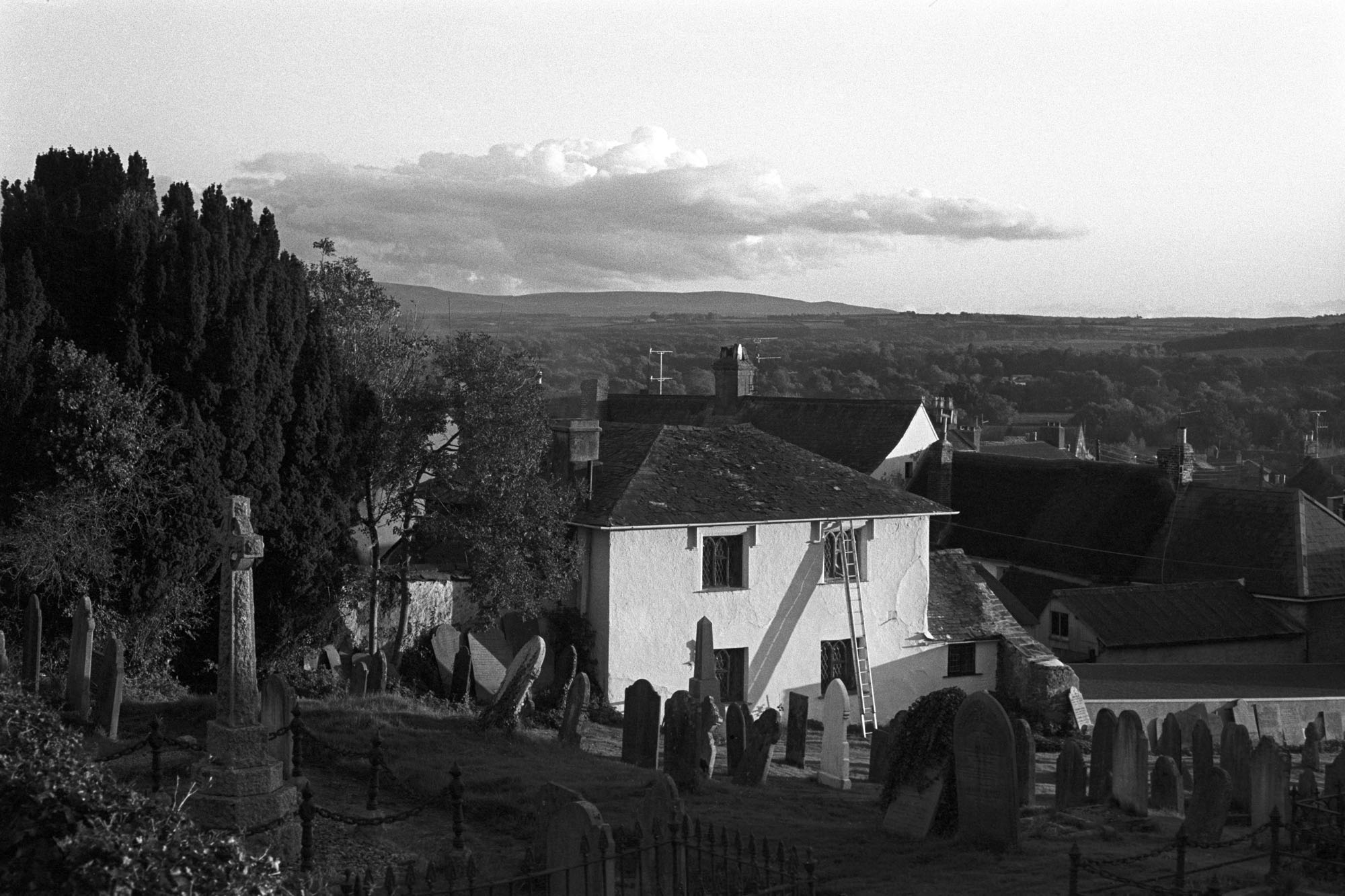 View towards Dartmoor from Hatherleigh churchyard by James Ravilious