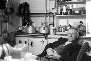 Bob Friend in the kitchen at Cawseys Farm by James Ravilious