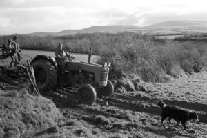 Mr Simmons on his tractor by James Ravilious