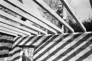 Clifford Palmer fixing beams in a new extension at Addisford by James Ravilious