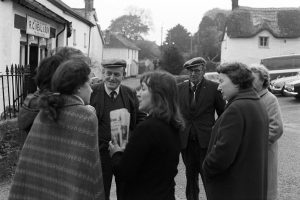 People chatting after the Carnival by James Ravilious