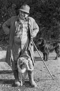 Archie Parkhouse with his dogs by James Ravilious