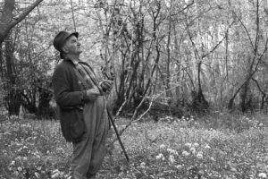 Archie Parkhouse in a wood near Dolton by James Ravilious