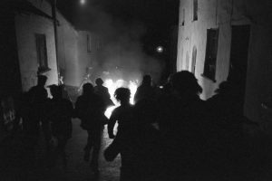 Running with tar barrels by James Ravilious