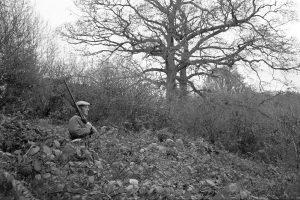 Man shooting at Addisford by James Ravilious