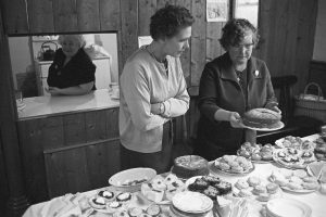 Cake stall at the Church Bazaar by James Ravilious