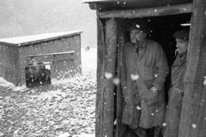 Archie Parkhouse and Ivor Brock sheltering from the snow by James Ravilious