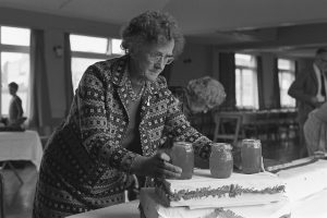 Doris Palfreyman setting out jam for sale by James Ravilious