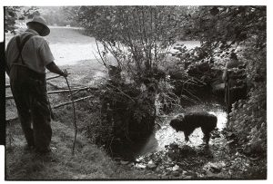 Archie Parkhouse and Ivor Brock looking at a stream in drought by James Ravilious