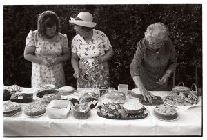 Cake stall at Chulmleigh Church Fete by James Ravilious