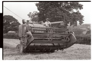 Combine harvester at Heanton Barton by James Ravilious