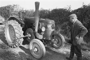 Owen Halwill with his Marshall tractor by James Ravilious