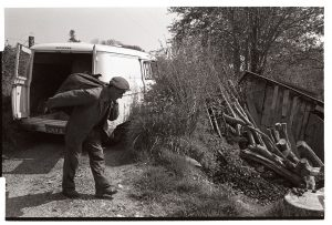 Man delivering coal by James Ravilious