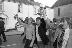 Victory parade with town band to celebrate winning the football cup by James Ravilious
