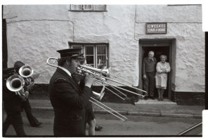 Hatherleigh Band parading to celebrate winning the football cup by James Ravilious