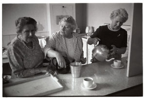 Women serving tea after the parade by James Ravilious