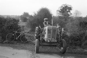 Morley King on his tractor by James Ravilious