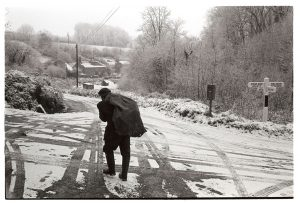 Ivor Brock carrying logs by James Ravilious