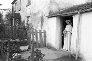 Mary Pugsley setting out for her wedding from her father's farm at Langham by James Ravilious