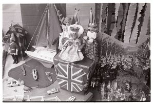 Toyshop window decorated for the Jubilee by James Ravilious