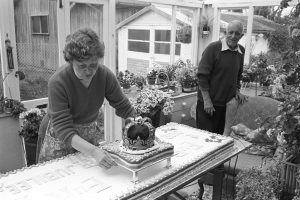 Joan and Cyril Dumbleton with Dolton's Jubilee cake by James Ravilious