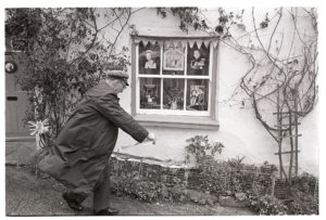 Jack Mardon decorating his house for the Jubilee by James Ravilious