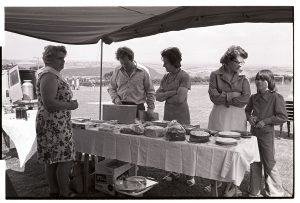 Cake stall at Atherington Village Fete by James Ravilious