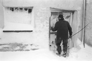 Alf Pugsley at the farm door after a blizzard by James Ravilious
