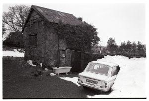 Cob barn and Hillman Imp