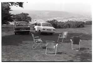 Empty picnic chairs by James Ravilious