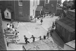Children in school playground by James Ravilious