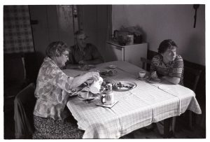 The Pugsley family having tea and watching television by James Ravilious