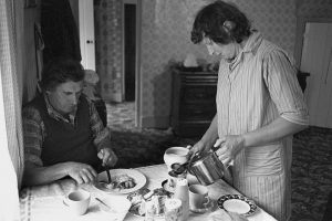 William and Valerie Medland having breakfast after the 7 o'clock milking by James Ravilious