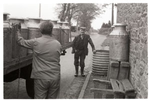 Gordon Sanders chatting to milk lorry driver by James Ravilious