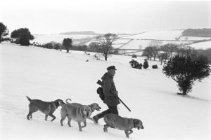 William Kelly out shooting in the snow by James Ravilious