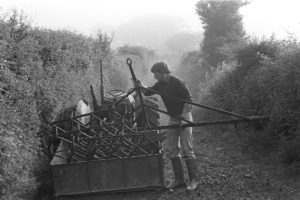 Simon Berry loading a linkbox by James Ravilious