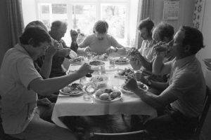 Reedcombers eating lunch by James Ravilious