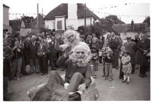 Boys in masks at Winkleigh Fair by James Ravilious