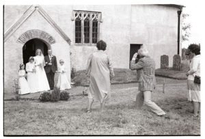 Wedding of Susan Westcott and Stephen Squire - the bride and her father arriving by James Ravilious