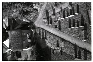 Gravestones in churchyard from Winkleigh church tower by James Ravilious