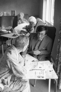 Dr Paul Bangay talking to an elderly patient