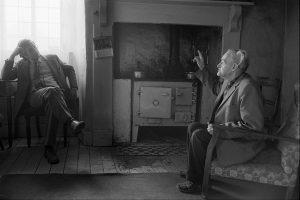 Dr Paul Bangay visiting an elderly man at his home by James Ravilious