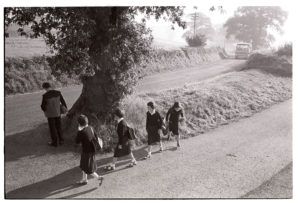 Children waiting for the school bus near Huish by James Ravilious