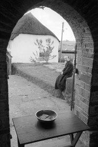 """The Revd. """"Bill"""" Smyth collecting money at the Roborough Revel by James Ravilious"""