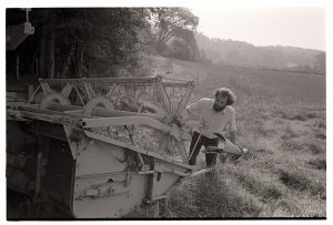 Farmers setting up the combine harvester by James Ravilious