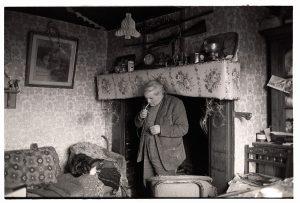Ivor Brock lighting his cigarette by James Ravilious