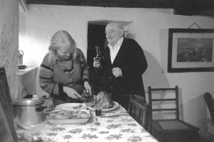 Jo Curzon carving the Christmas turkey by James Ravilious