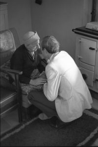 Dr Richard Westcott visiting Lizzie Symons by James Ravilious