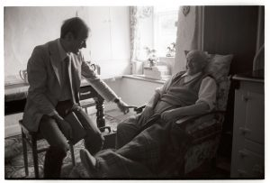Dr Richard Westcott talking to a patient by James Ravilious